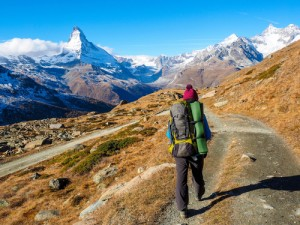 Matterhorn in early morning and trekker with outdoor equipment , Zermatt, Switzerland
